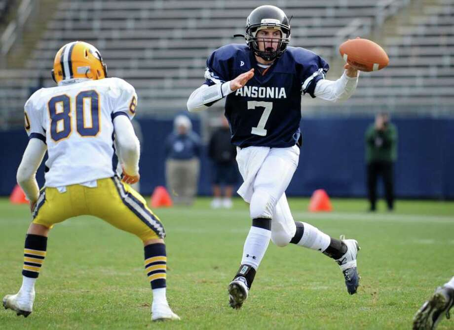 Ansonia quarterback Elliot Chudwick makes a short pass as Ledyard's Cal Williams defends Saturday, Dec. 10, 2011 during the Class M State Championship football game at Rentschler Field in East Hartford, Conn. Photo: Autumn Driscoll / Connecticut Post
