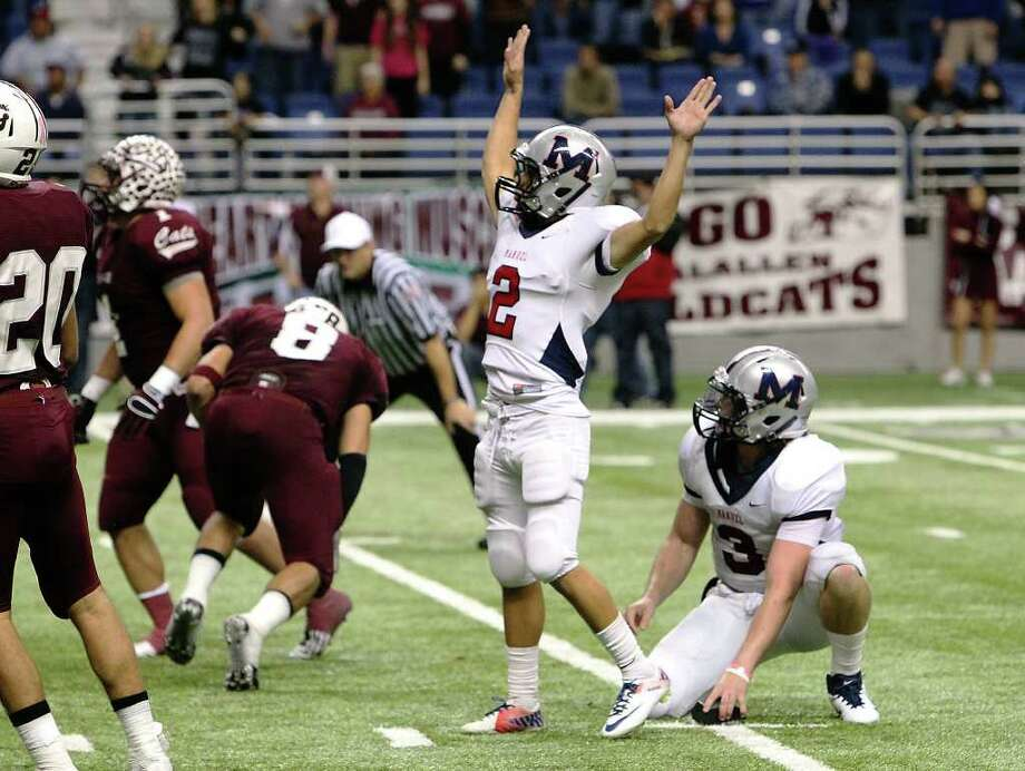 Manvel kicker Josh Martinez (02) and quarterback Shane McCarley (03) track Martinez's kick toward the goalpost to score the winning goal with no time left in the game to defeat CalAllen in Class 4A Div. II state semifinals in football at the Alamodome in San Antonio on Saturday, Dec. 10, 2011. Manvel defeated CalAllen, 31-28, to advance to the state finals. Kin Man Hui/San Antonio Express-News/kmhui@express-news.net Photo: KIN MAN HUI, SAN ANTONIO EXPRESS-NEWS / SAN ANTONIO EXPRESS-NEWS
