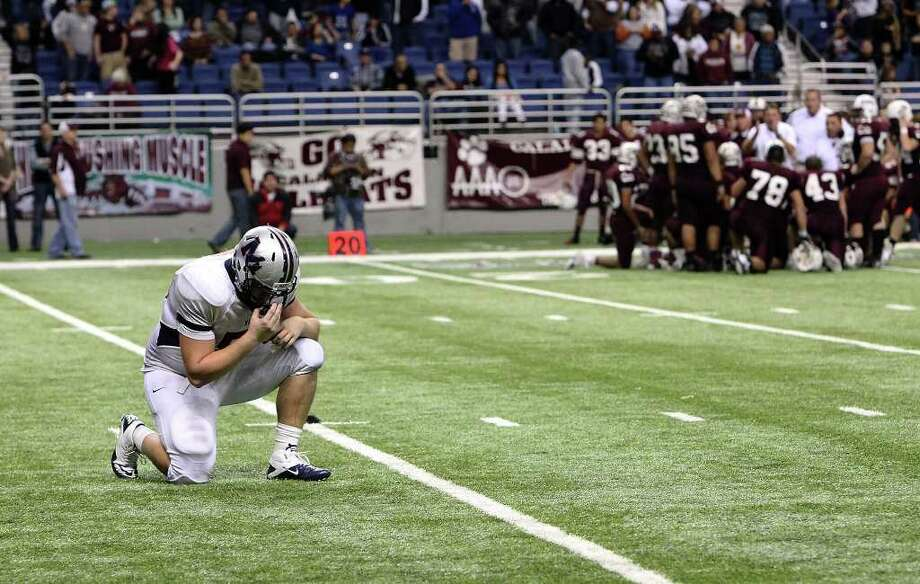 Manvel offensive lineman Taylor Romero (left) kneels for a prayer before the Mavericks attempt a winning field goal against CalAllen in Class 4A Div. II state semifinals in football at the Alamodome in San Antonio on Saturday, Dec. 10, 2011. Manvel defeated CalAllen, 31-28, to advance to the state finals. Kin Man Hui/San Antonio Express-News/kmhui@express-news.net Photo: KIN MAN HUI, SAN ANTONIO EXPRESS-NEWS / SAN ANTONIO EXPRESS-NEWS