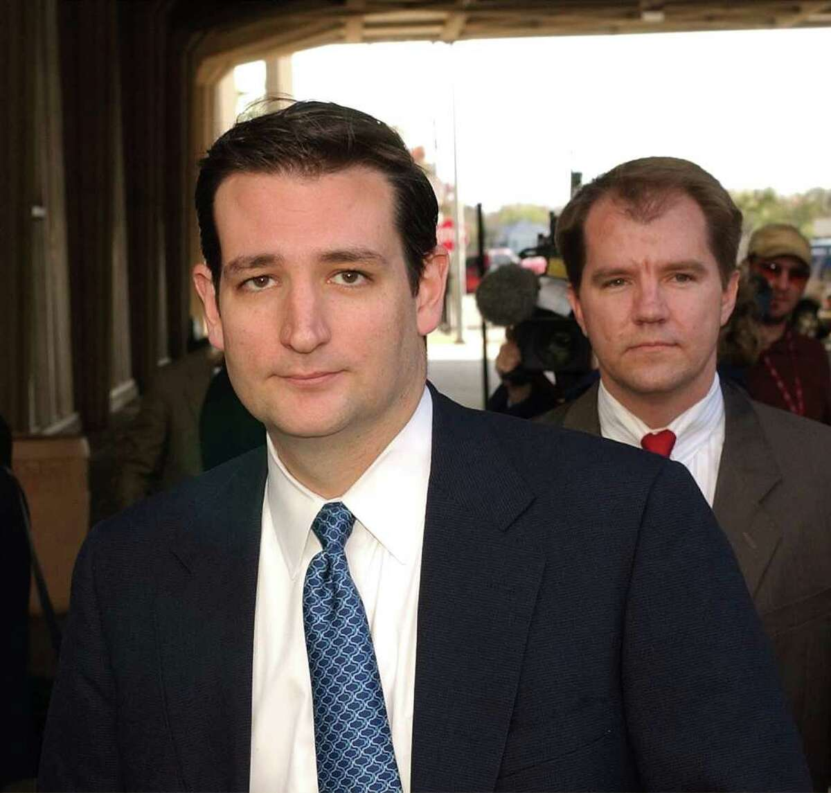 Texas Solicitor General R. Ted Cruz, left, and Don. R. Willett, right, leave the federal courthouse after a pre-trial hearing on Tuesday, Dec. 9, 2003, in Austin, Texas. Lawyers and federal judges met earlier to plan for the upcoming redistricting trial. Willett is deputy Attorney General for Legal Counsel. (AP Photo/Harry Cabluck). Used as mug. HOUCHRON CAPTION (06/27/2005 -2 - STAR) SECMETRO COLORFRONT : TED CRUZ, solicitor general, will ask justices to defer to lawmakers in upcoming argument.