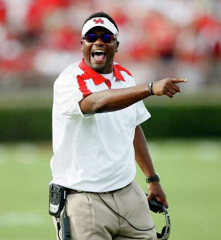 HOUSTON - SEPTEMBER 03:  Head coach Kevin Sumlin of the Houston Cougars attempts to get the attention of the referee at Robertson Stadium on September 3, 2011 in Houston, Texas. Photo: Bob Levey, Getty Images / 2011 Getty Images
