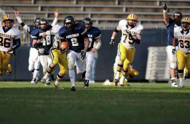 Ansonia's Arkeel Newsome takes off on the carry Saturday, Dec. 10, 2011 during the Class M State Championship football game against Ledyard at Rentschler Field in East Hartford, Conn. Photo: Autumn Driscoll / Connecticut Post
