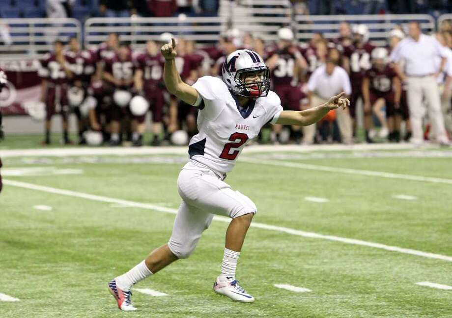 Manvel kicker Josh Martinez (02) celebrates after kicking the winning goal against CalAllen in Class 4A Div. II state semifinals in football at the Alamodome in San Antonio on Saturday, Dec. 10, 2011. Manvel defeated CalAllen, 31-28, to advance to the state finals. Kin Man Hui/San Antonio Express-News/kmhui@express-news.net Photo: KIN MAN HUI, SAN ANTONIO EXPRESS-NEWS / SAN ANTONIO EXPRESS-NEWS
