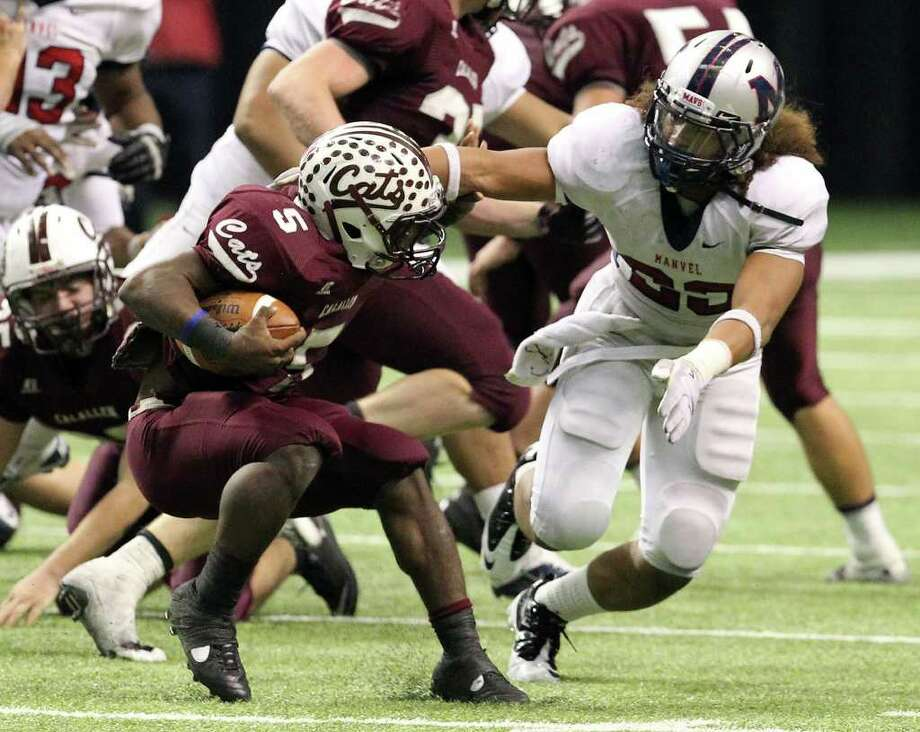 Manvel's Seth Langford (23) goes for a tackle against CalAllen's Marcus Price (05) in the fourth quarter in Class 4A Div. II state semifinals in football at the Alamodome in San Antonio on Saturday, Dec. 10, 2011. Manvel defeated CalAllen, 31-28, to advanc to the state finals. Kin Man Hui/San Antonio Express-News/kmhui@express-news.net Photo: KIN MAN HUI, SAN ANTONIO EXPRESS-NEWS / SAN ANTONIO EXPRESS-NEWS