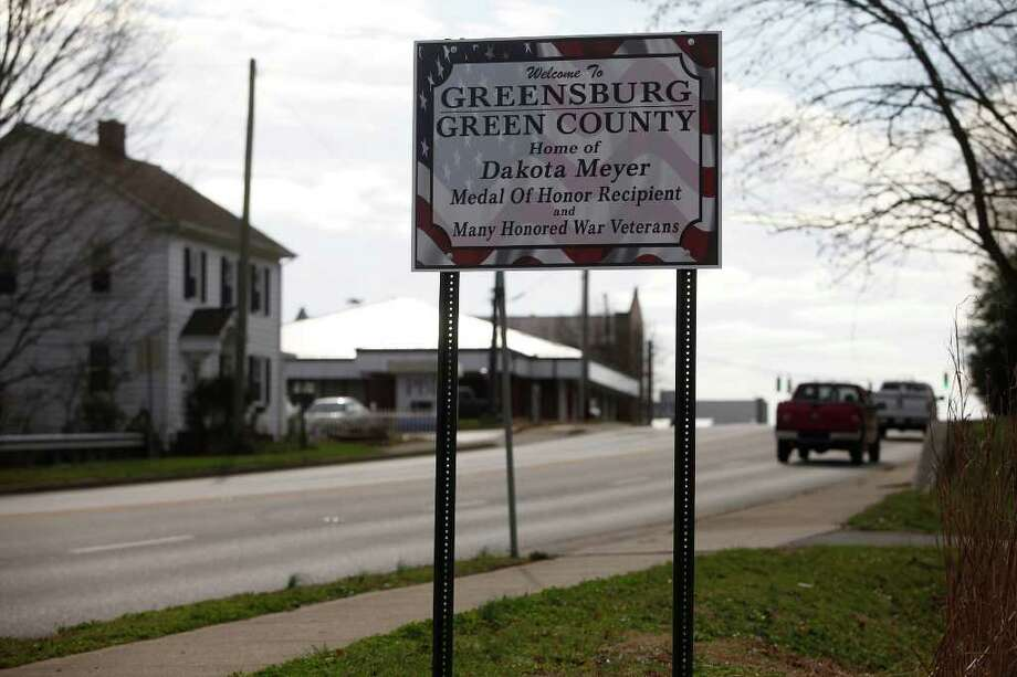 A sign featuring Dakota Meyer's name and honor welcomes visitors to Greensburg, KY on Sunday, Dec. 4, 2011.  Meyer grew up on a farm between Greensburg and Columbia, KY and attended schools in both towns.  Photo: LISA KRANTZ, SAN ANTONIO EXPRESS-NEWS / SAN ANTONIO EXPRESS-NEWS
