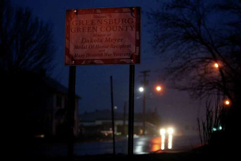 A sign featuring Dakota Meyer's name and honor welcomes visitors to Greensburg, KY as dusk falls on Monday, Dec. 5, 2011.  Meyer grew up on a farm between Greensburg and Columbia, KY and attended schools in both towns.  Photo: LISA KRANTZ, SAN ANTONIO EXPRESS-NEWS / SAN ANTONIO EXPRESS-NEWS