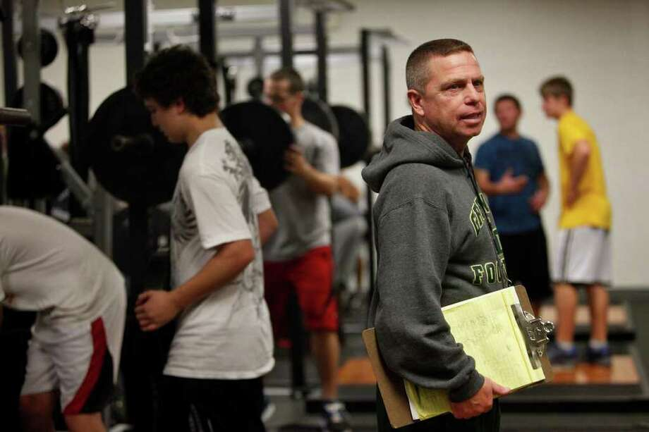 Green County High School head football coach Mike Griffiths, who is a mentor to Dakota Meyer, teaches an advanced strength training and conditioning class at the school where Dakota played football and graduated from in Greensburg, KY on Monday, Dec. 5, 2011.  Photo: LISA KRANTZ, SAN ANTONIO EXPRESS-NEWS / SAN ANTONIO EXPRESS-NEWS