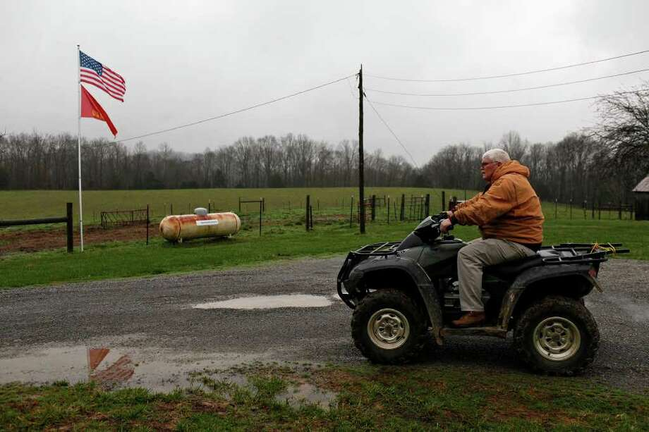 Mike Meyer, the father of Medal of Honor recipient Dakota Meyer, works at the family home and farm in Adair County, where Dakota Meyer grew up, between Greensburg and Columbia, KY, on Tuesday, Dec. 6, 2011.  Photo: LISA KRANTZ, SAN ANTONIO EXPRESS-NEWS / SAN ANTONIO EXPRESS-NEWS