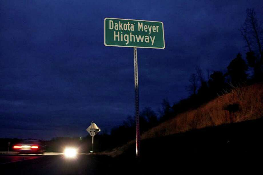 Dusk falls on Dakota Meyer Highway, the portion of Highway 61 between Columbia and Greensburg, Ky., that runs near the farm where he grew up. The highway was recently named for him. Photo: LISA KRANTZ, SAN ANTONIO EXPRESS-NEWS / SAN ANTONIO EXPRESS-NEWS