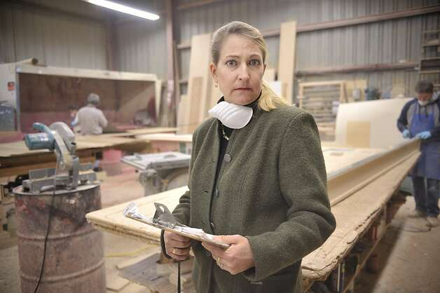 Joanne Gomez, who runs  West Bay Plastics, a family-owned countertop business has had trouble collecting payments from clients. Photo: David Butow, Special To The Chronicle