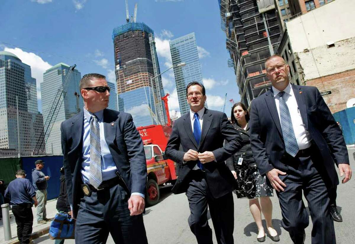 Gov. Dan Malloy leaves Ground Zero in New York City on May 5, 2011, after attending a tribute to the victims of the Sept. 11, 2001 terrorist attacks led by President Obama after Osama bin Laden was killed. Malloy's security detail, Trooper Steven Zonghetti and Trooper Dan Rybacki lead the way as Arielle Reich trails behind.