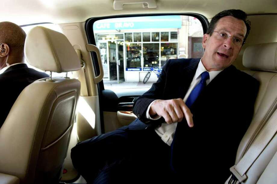 Gov. Dan Malloy leaves New York City in the back seat of his SUV after his security detail learned of a threat against him. The governor attended a tribute to the victims of the Sept. 11, 2001 terrorist attacks at the World Trade Center led by President Obama on May 5, 2011. Photo: Kathleen O'Rourke / Stamford Advocate