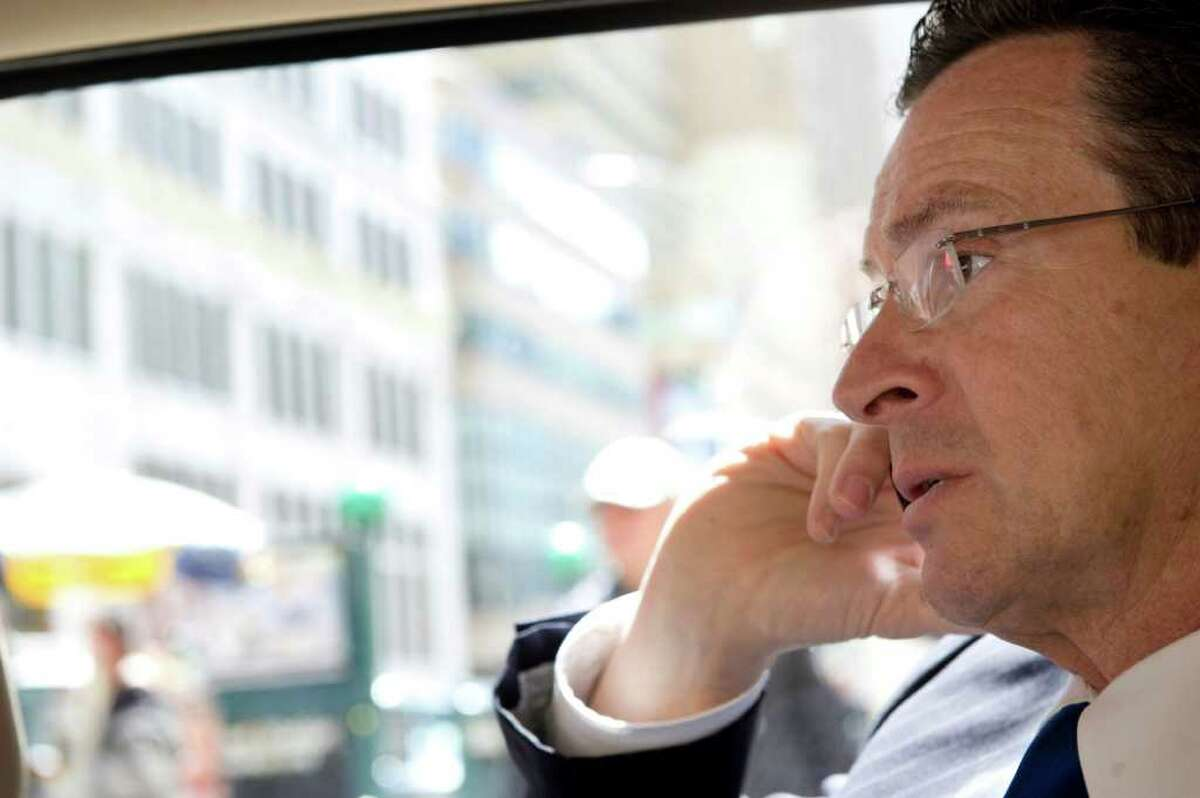 Gov. Dan Malloy on the phone as he leaves New York City after President Obama led a tribute to the victims of the Sept. 11, 2001 terrorist attacks at the World Trade Center on May 5, 2011.