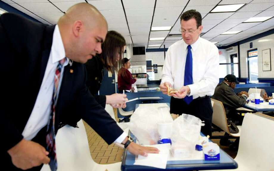 Trooper Rich Garcia, Arielle Reich and Gov. Dan Malloy prepare to have lunch at White Castle in the Bronx on their way to back to Hartford from Ground Zero in New York City on May 5, 2011. White Castle was a favorite stop for Malloy when he was returning from Rugby matches at Randalls Island. Photo: Kathleen O'Rourke / Stamford Advocate