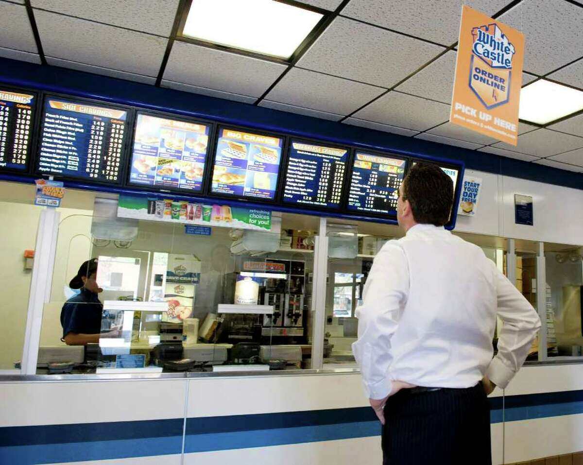 Gov. Dan Malloy checks out the menu at White Castle in the Bronx. Malloy and his staff stopped for lunch on their way to back to Hartford from Ground Zero in New York City on May 5, 2011. White Castle was a favorite stop for Malloy when he was returning from Rugby matches at Randalls Island.