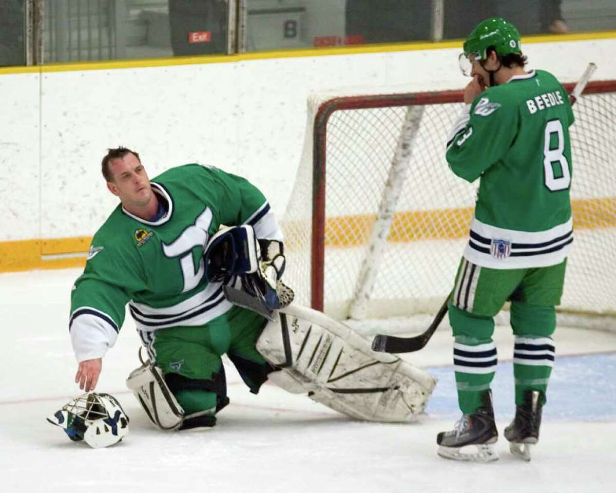 Danbury Whalers goalie Peter Maro, left, warms up before making his Federal Hockey League debut last Sunday at the Danbury Arena. Maro is a 46-year-old orthodontist.