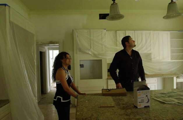 "David and Melina Montelongo, formerly of ""Flip this House,"" are shown revamping a house in the Monte Vista area in this file photo. Photo: HELEN L. MONTOYA, SAN ANTONIO EXPRESS-NEWS / SAN ANTONIO EXPRESS-NEWS"