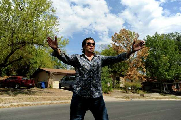 "In this file photo, Armando Montelongo Jr., who shot to fame as a star of the A&E show ""Flip This House,"" examines a San Antonio hous. Photo: BILLY CALZADA, SAN ANTONIO EXPRESS-NEWS / gcalzada@express-news.net"