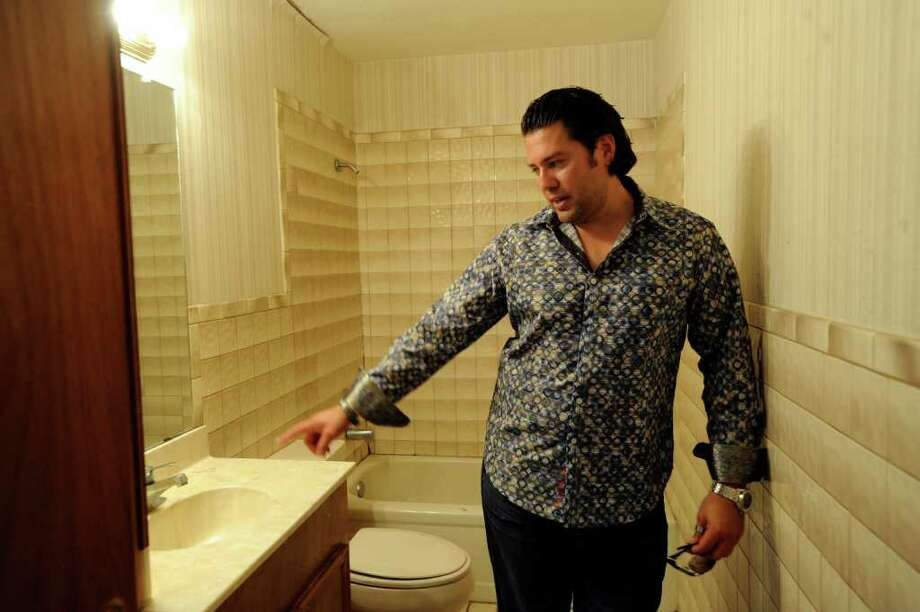 In September, 2007, Armando Montelongo described improvements that are needed before this house can be sold. Photo: BILLY CALZADA, SAN ANTONIO EXPRESS-NEWS / gcalzada@express-news.net