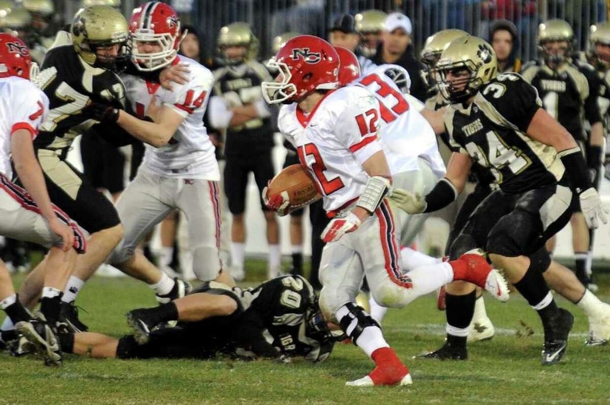Highlights from CIAC Class L boys football championship action between New Canaan and Daniel Hand in East Haven, Conn. on Saturday December 10, 2011. New Canaan's #12 Duke Repko carries the ball.