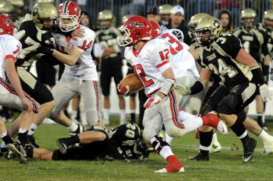 Highlights from CIAC Class L boys football championship action between New Canaan and Daniel Hand in East Haven, Conn. on Saturday December 10, 2011. New Canaan's #12 Duke Repko carries the ball. Photo: Christian Abraham / www.connpost.com