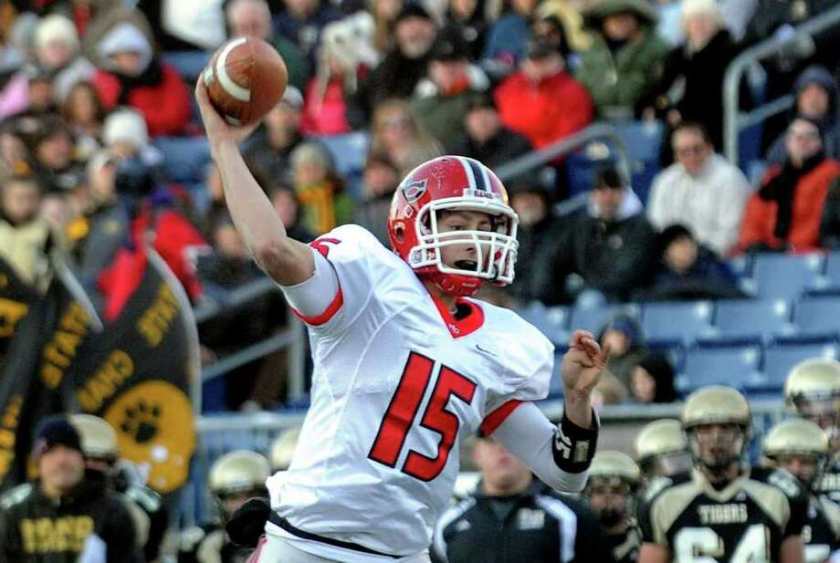 Highlights from CIAC Class L boys football championship action between New Canaan and Daniel Hand in East Haven, Conn. on Saturday December 10, 2011. New Canaan QB Matthew Milano. Photo: Christian Abraham / www.connpost.com