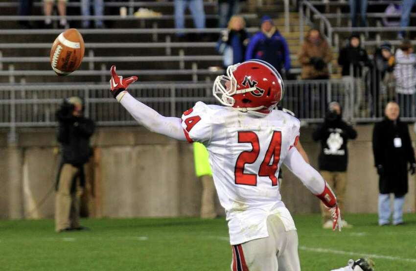 Highlights from CIAC Class L boys football championship action between New Canaan and Daniel Hand in East Haven, Conn. on Saturday December 10, 2011. New Canaan's #24 Patrick Newton misses a catch in the endzone.
