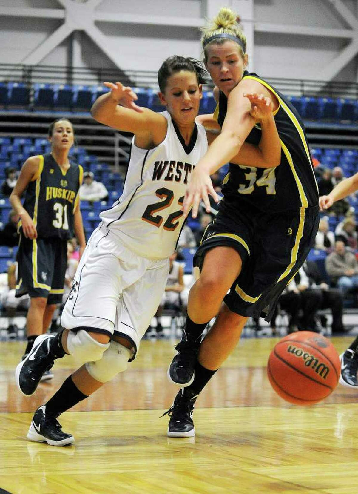 Western Connecticut State University's Carly Murphy battles University of Southern Maine's Courtney Cochran for the loose ball during their game at the O'Neill Center on WestConn's Westside campus on Saturday, Dec. 10, 2011. Southern Maine won 77-76 in overtime.