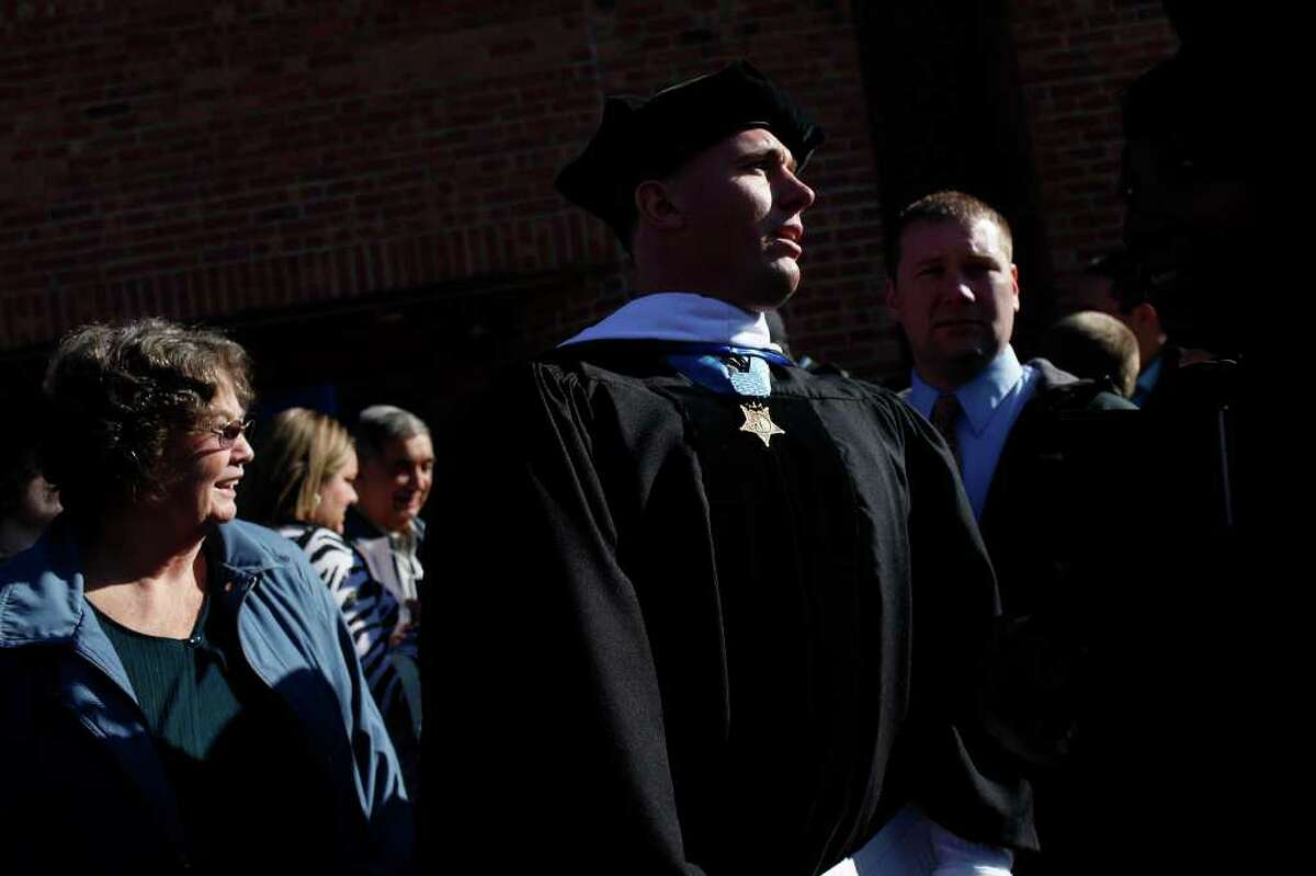 Dakota Meyer looks for his family after the Lindsey Wilson College Commencement where he received a Honorary Doctorate Degree from the college in Columbia, KY, where he was born and grew up, on Saturday, Dec. 10, 2011.