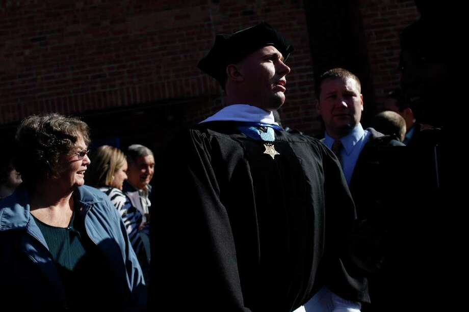 Dakota Meyer looks for his family after the Lindsey Wilson College Commencement where he received a Honorary Doctorate Degree from the college in Columbia, KY, where he was born and grew up, on Saturday, Dec. 10, 2011.  Photo: LISA KRANTZ, SAN ANTONIO EXPRESS-NEWS / SAN ANTONIO EXPRESS-NEWS