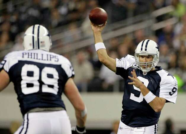 Dallas Cowboys quarterback Tony Romo (9) throws to tight end John Phillips (89) in the first half of an NFL football game against the Miami Dolphins, Thursday, Nov. 24, 2011, in Arlington, Texas. Photo: AP