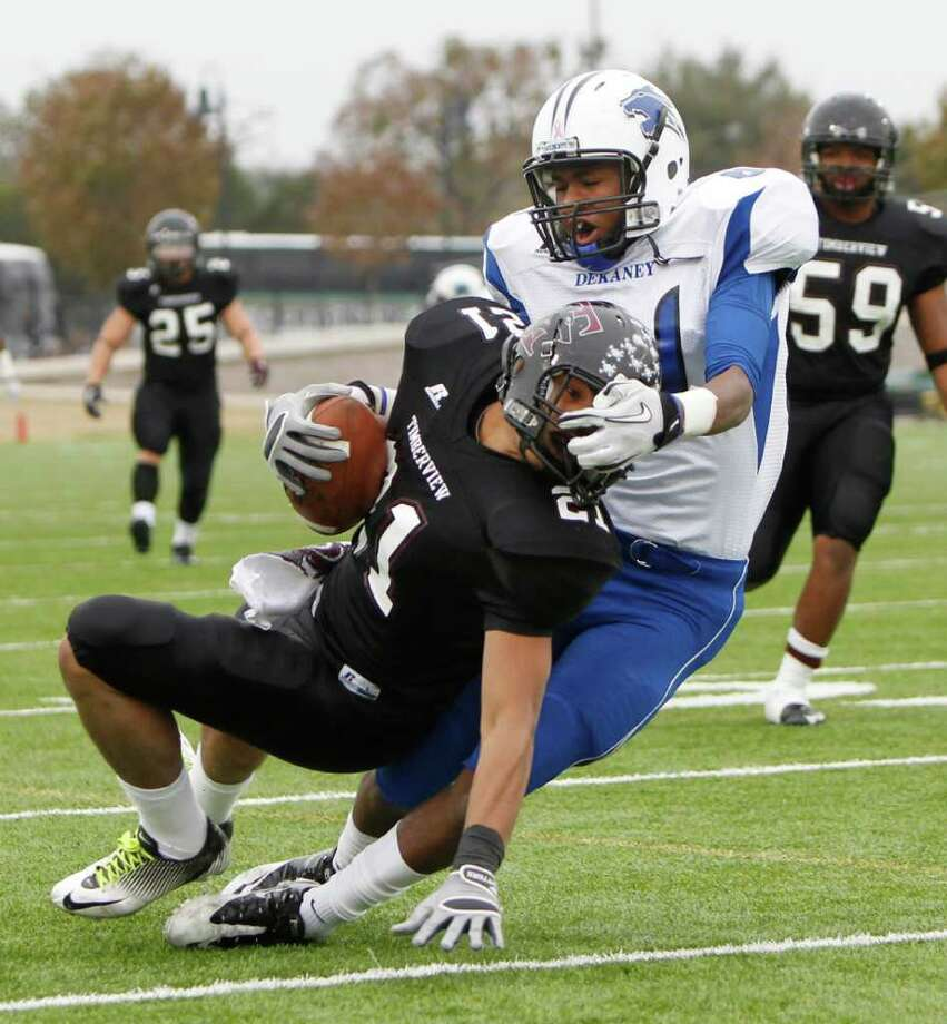 12/10/11 -  Dekaney wide receiver Austin Garrett (81) brings down Mansfield Timberview defensive back Edward Paris (21) after Paris' interception in the UIL 5A Division II semifinals Round Rock, Texas Saturday December 10, 2011. (Erich Schlegel/Special Contributor) Photo: Erich Schlegel, Houston Chronicle / ©2011 Erich Schlegel