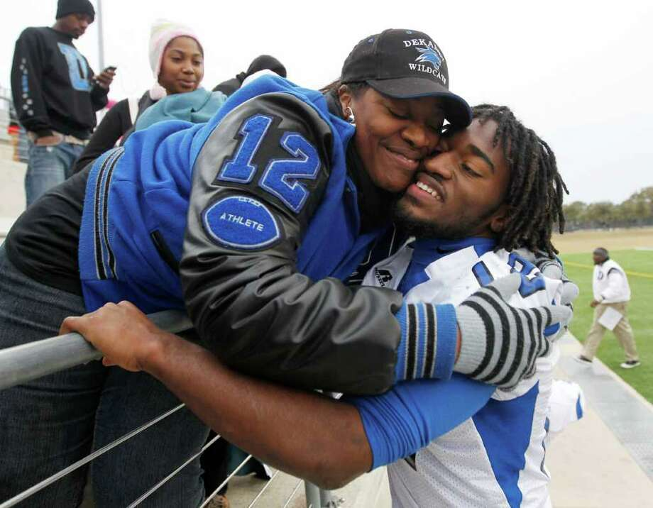 12/10/11 -  Dekaney quarterback D'Juan Hines gets a hug from his mother Kris Larose after defeating Mansfield Timberview in the UIL 5A Division II semifinals Round Rock, Texas Saturday December 10, 2011. (Erich Schlegel/Special Contributor) Photo: Erich Schlegel, Houston Chronicle / ©2011 Erich Schlegel