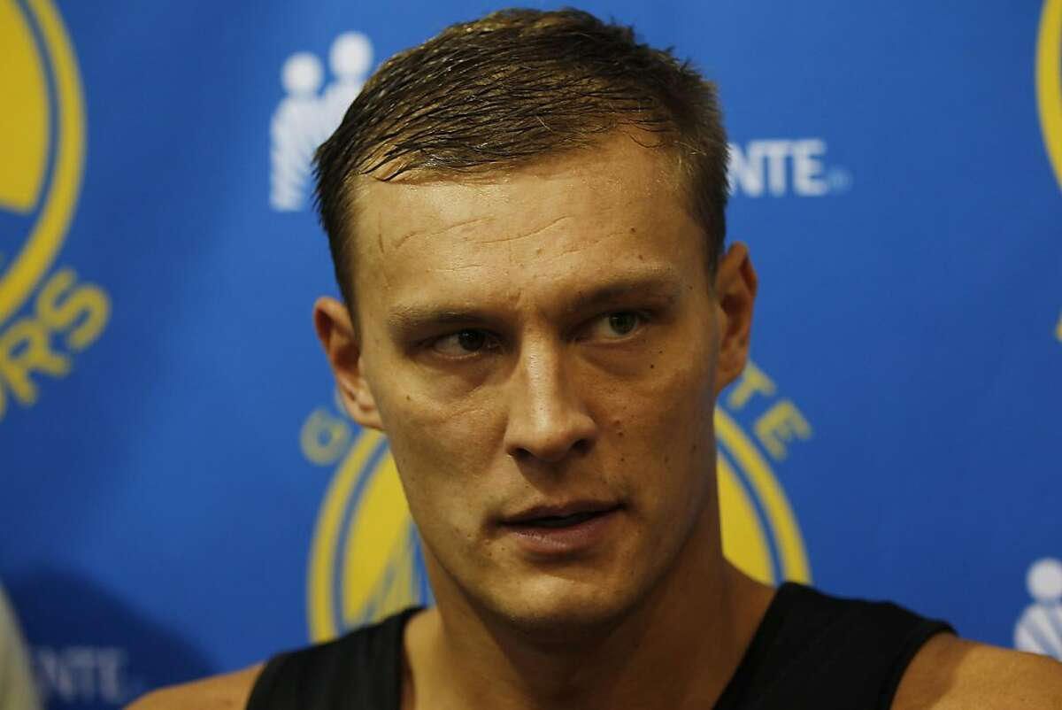 Andris Biedrins of the Golden State Warriors speaks to reporters after first day of training camp at Golden State Warriors Practice Facility in Oakland, Calif. on Friday, Dec. 9, 2011.