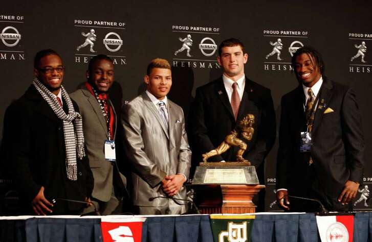 NEW YORK, NY - DECEMBER 10:  (L-R) Heisman Trophy finalists running back Trent Richardson of the Alabama Crimson Tide, running back Montee Ball of the Wisconsin Badgers, cornerback Tyrann Mathieu of the LSU Tigers, Andrew Luck of the Stanford University Cardinal and quarterback Robert Griffin III of the Baylor Bears pose with the Heisman Trophy after a press conference at The New York Marriott Marquis on December 10, 2011 in New York City.