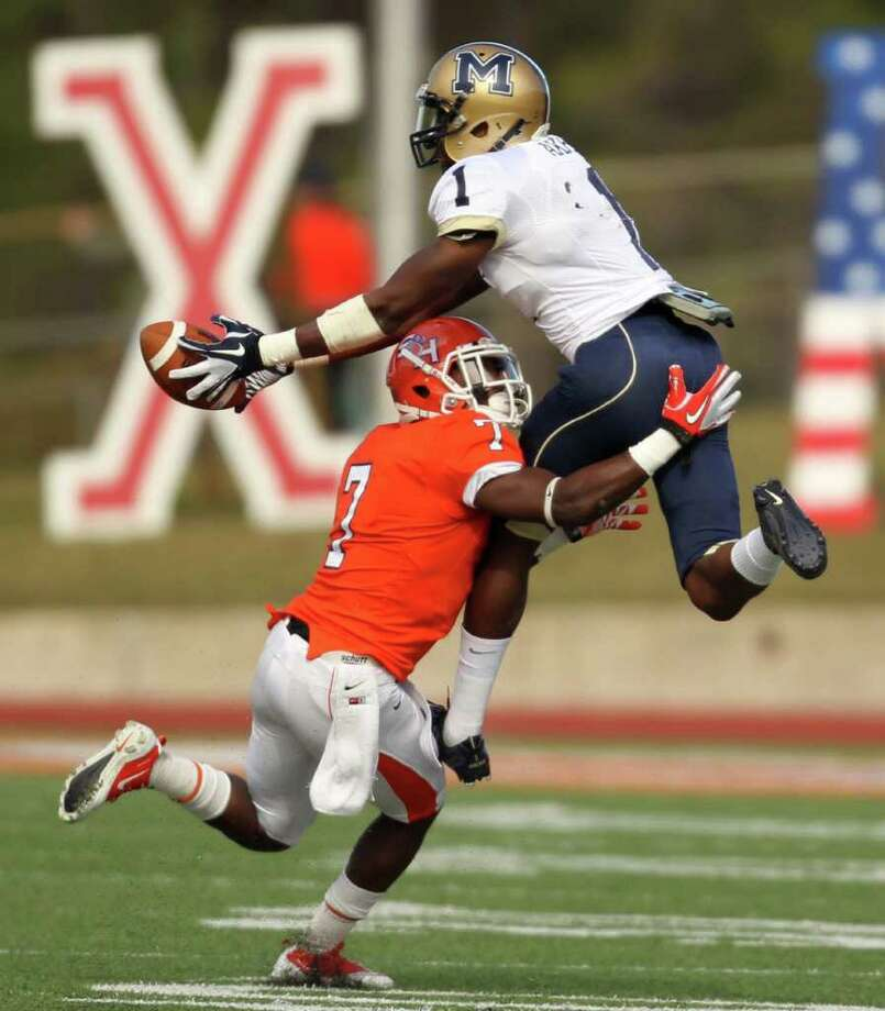 Montana State's Elvis Akpla makes a leaping reception over Sam Houston's Daxton Swanson during the first half of a NCAA Division I football playoff quarterfinal, Saturday, December 10, 2011, at Bowers Stadium in Huntsville, TX. Photo: Eric Christian Smith, For The Chronicle