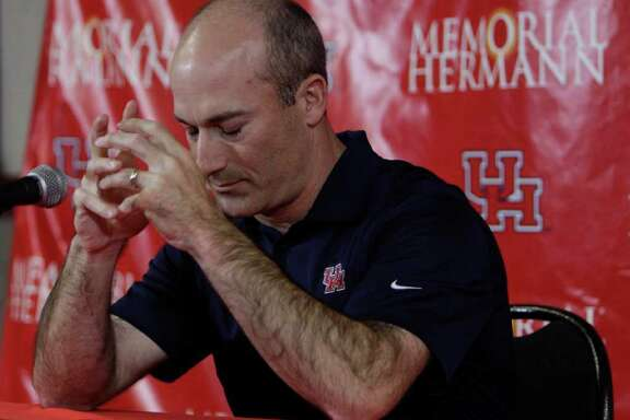 University of Houston interim head football coach Tony Levine pauses to control his reaction to a question about the emotions of the day during media conference in the Carl Lewis Auditorium of the UH Athletics Alumni Center Saturday, Dec. 10, 2011, in Houston. Former Houston Cougars head coach Kevin Sumlin left to become the head coach at Texas A&M.