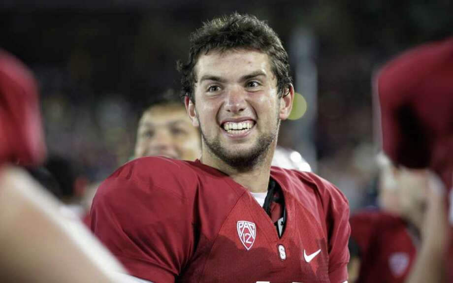 FILE - In this Oct. 22, 2011 file photo, Stanford quarterback Andrew Luck smiles on the sidelines in the final minute of an NCAA college football game against Washington in Stanford, Calif. Luck is a finalist for the Heisman Award. Photo: AP
