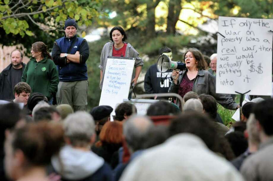 Rebecca Tell of Albany, a facilitator for the general assembly, right, speaks during Occupy Albany on Friday, Oct. 21, 2011, at Academy Park in Albany, N.Y. (Cindy Schultz / Times Union) Photo: Cindy Schultz / 00015065A