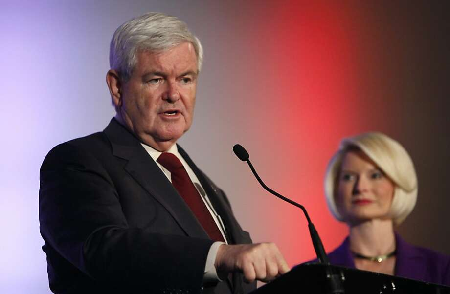 Republican presidential candidate and former House Speaker Newt Gingrich speaks during the Iowa Veterans Presidential Candidate Forum as his wife Callista looks on, Saturday, Dec. 10, 2011, in Des Moines, Iowa. (AP Photo/Charlie Neibergall)  Ran on: 12-11-2011 GOP presidential candidate Newt Gingrich speaks at a forum in Iowa as his wife, Callista, listens. Photo: Charlie Neibergall, AP