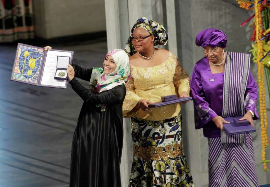 Nobel Peace Prize winners Tawakkol Karman of Yemen, left, Liberian peace activist Leymah Gbowee, center,  and Liberian president Ellen Johnson-Sirleaf receive their diplomas and medals at City Hall in in Oslo, Norway Saturday Dec. 10, 2011. The peace prize committee awarded the prize to Karman,  Johnson-Sirleaf and Gbowee for championing women's rights in regions where oppression is common and helping women participate in peace-building. Photo: JOHN MCCONNICO / AP