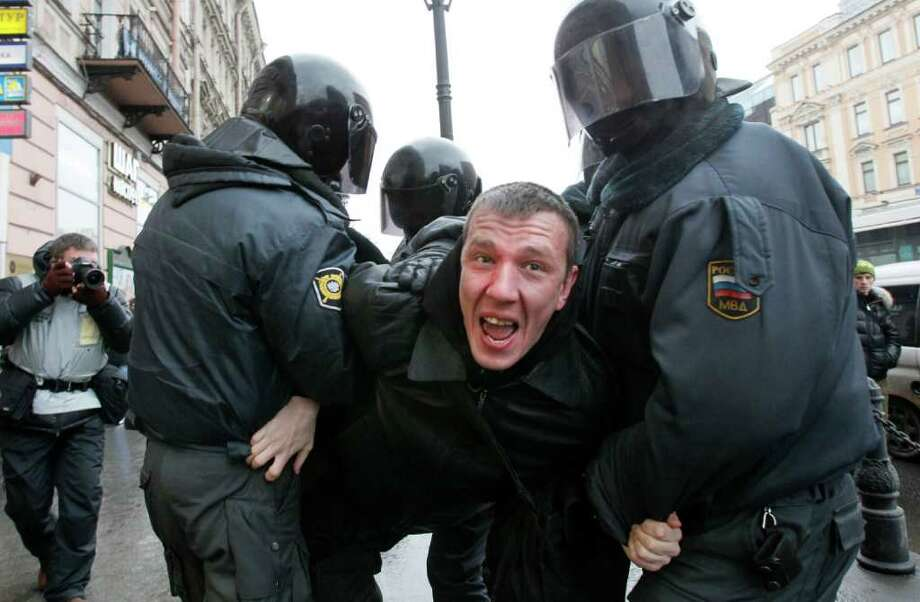 Riot police detain a protester during a rally in downtown  St.Petersburg, Russia, Saturday, Dec. 10, 2011. More than ten thousands people have protested in St.Petersburg against Prime Minister Vladimir Putin and his party, which won the largest share of a parliamentary election that observers said was rigged.  (AP Photo/Dmitry Lovetsky) Photo: Dmitry Lovetsky / AP