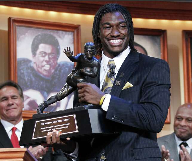 Robert Griffin III, of Baylor University, holds the Heisman Trophy award after being named the winne