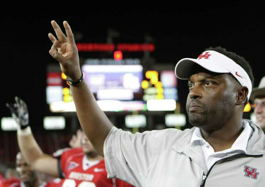 The University of Houston head coach Kevin Sumlin stops for the university's school song after beating East Carolina University Stadium on Saturday, Oct. 8, 2011, in Houston.  ( Nick de la Torre / Houston Chronicle ) Photo: Nick De La Torre / © 2011  Houston Chronicle