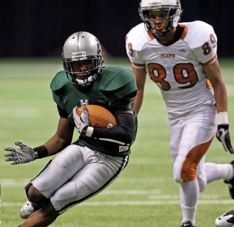 SPORTS  Hurricane running back Joshua Wilhite turns through a gap in the first half as Madison plays Fort Bend Hightower at the Alamodome in the state semifinal playoffs on December 10, 2011 Tom Reel/Staff Photo: TOM REEL, SAN ANTONIO EXPRESS-NEWS / © 2011 San Antonio Express-News