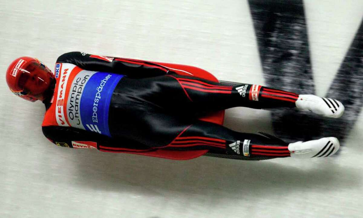 Felix Loch, of Germany, slides during his second run of the World Cup luge competition in Whistler, British Columbia, Friday, Dec. 9, 2011. (AP Photo/The Canadian Press, Jonathan Hayward)
