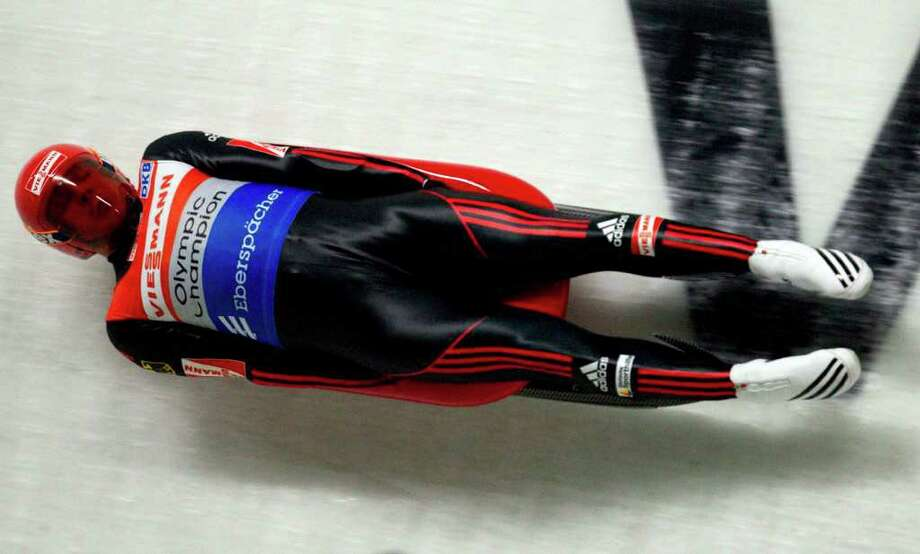 Felix Loch, of Germany, slides during his second run of the World Cup luge competition in Whistler, British Columbia, Friday, Dec. 9, 2011. (AP Photo/The Canadian Press, Jonathan Hayward) Photo: Jonathan Hayward