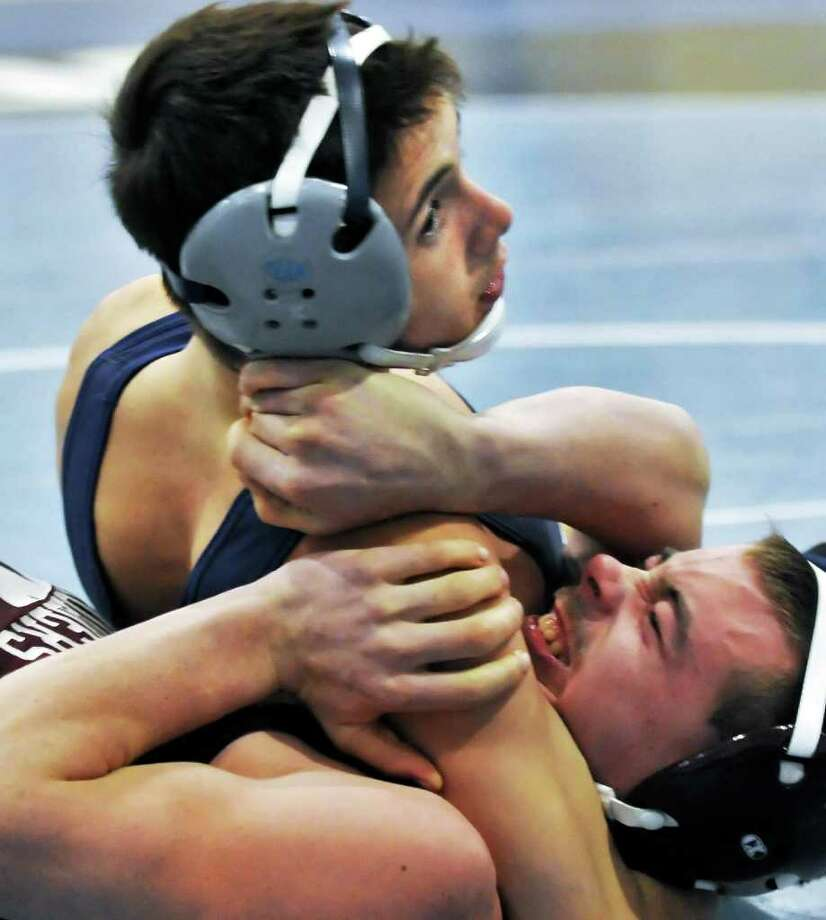 Columbia's Matt Green, top, pins Whitehall's Dylan Younger in a 132 lb. match as Columbia High School hosts a wrestling dual meet in East Greenbush Saturday Dec. 10, 2011.   (John Carl D'Annibale / Times Union) Photo: John Carl D'Annibale / 00015733A
