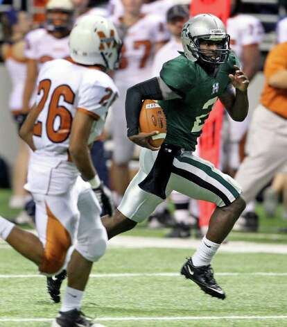 Hurricane quarterback Bralon Addison rolls around to the left for a touchdown in the first half as Madison plays Fort Bend Hightower at the Alamodome in the state semifinal playoffs on December 10, 2011 Tom Reel/Staff Photo: TOM REEL, Express-News / © 2011 San Antonio Express-News