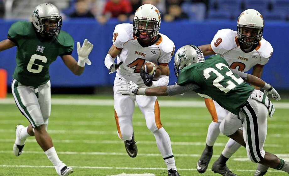 Madison receiver Byron Daniels loks for room to run in the second half as Madison plays Fort Bend Hightower at the Alamodome in the state semifinal playoffs on December 10, 2011 Tom Reel/Staff Photo: TOM REEL, Express-News / © 2011 San Antonio Express-News